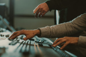Audio engineers at mastering desk
