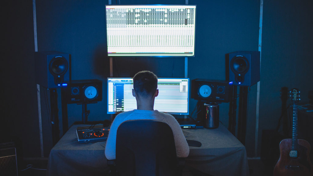 Person editing music